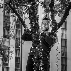 Christmas in the City (John St John Photography) Tags: streetphotography candidphotography christmas lights tree worker bw blackandwhite blackwhite blackwhitephotos johnstjohnphotography