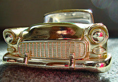Golden Grille. (dccradio) Tags: lumberton nc northcarolina robesoncounty indoor indoors inside gold flickrfriday carpet goldcolored golden chevy chevrolet belair diecast 124 car vehicle toy toycar january saturday morning goodmorning saturdaymorning lights headlights sun sunlight bumper windshield classiccar antiquecar vintagecar oldcar nascar stockcar stockrods stevegrissom grissom replica sony cybershot dscw230 reflection camerareflection racingchampions