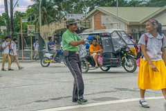 Traffic Enforcer (Beegee49) Tags: street traffic enforcer man schoolgirl dancing crossing filipino filipina sony a6000 planet happy children bata bacolod city philippines asian