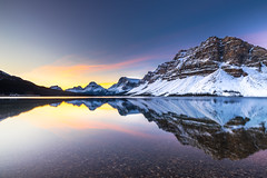 Bow lake Sunrise (Bluesky251) Tags: alberta banff banffnationalpark beautiful blue bowlake bright canada cloud cloudline cold color colorful daylight daytime glow lake landscape light mountains mountainscape national nationalpark natural nature outdoor outside photography planet reflection rock season sky skyline snow sunrise tour tourist travel trees water weather white winter world view