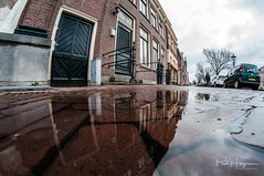 Puddle reflections @ Alkmaar (PaulHoo) Tags: nikon d300s fisheye samyang 8mm 2018 city urban cityscape alkmaar reflection street door building exterior puddle rainy