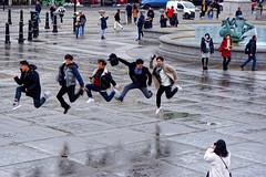 Jump (Croydon Clicker) Tags: jump tourists photograph asian london pavement fountain people street fun