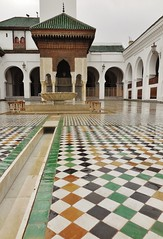 courtyard on a rainy day (SM Tham) Tags: africa morocco fes feselbali medina walledcity alqarawiyyin alkaraouine mosque university madrasa courtyard islamic architecture arches tiles waterchannel patterns leadinglines