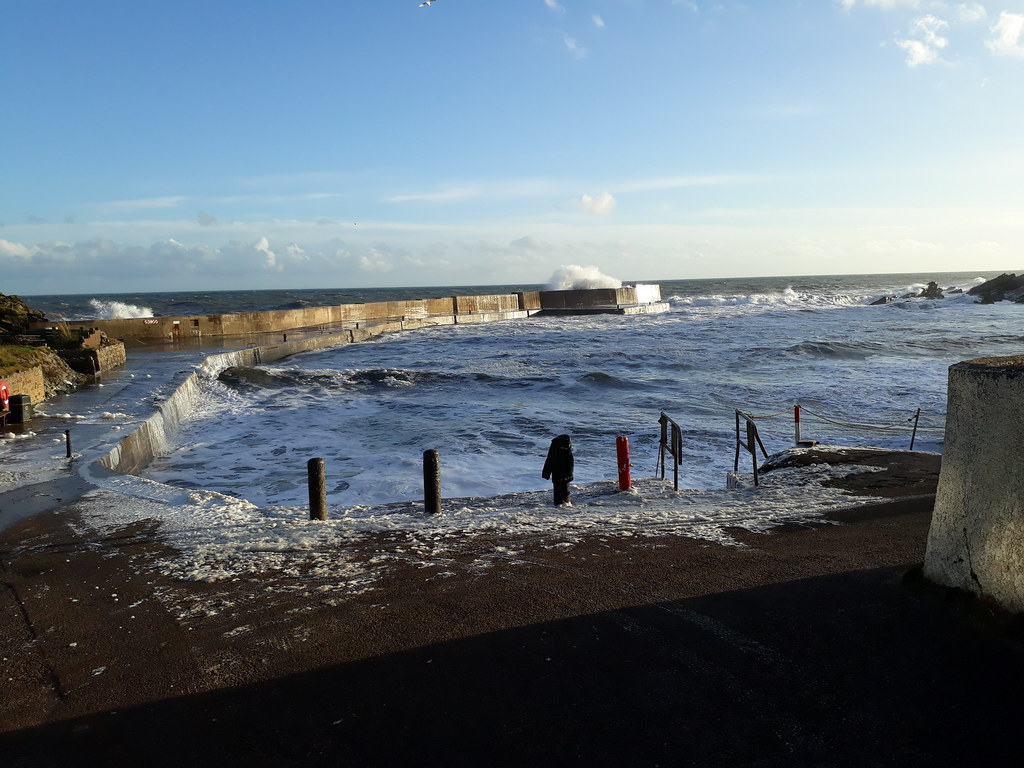 Collieston on a very stormy afternoon at high tide
