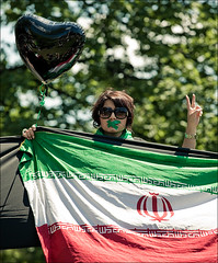 girl_iran_flag_queens-park_01 (wvs) Tags: iran crowd demonstration event iranelection mourning park queenspark rally toronto ontario canada can