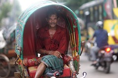 Let's Say I am Smokey (N A Y E E M) Tags: rickshawwalla red colors candid portrait smile afternoon street norahmedroad chittagong bangladesh carwindow