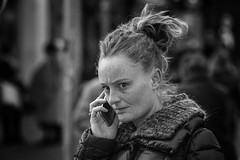 Tense (Frank Fullard) Tags: frankfullard fullard tense intense candid street portrait lady listening mobile phone telephone call cork irish ireland black white emotion face expression worry blanc noir
