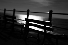 untitled (ChrisRSouthland (mostly off, traveling & working)) Tags: bench water sea promenade nikond800 nikkor85mmf18 contraluz contrast intothelight lines blackandwhite blackwhite monochrome bw artistic