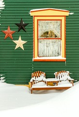 3 Stars (Karen_Chappell) Tags: house star stars winter snow nfld stjohns newfoundland canada december green yellow orange bench seat window architecture clapboard wod wooden paint painted building christmas holiday noel xmas eastcoast avalonpeninsula atlanticcanada downtown city urban red jellybeanrow rowhouse home colourful colours multicoloured colour