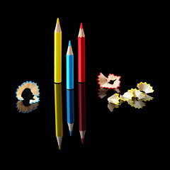 Get to the Point (njk1951) Tags: pencils coloredpencils red blue yellow pencilshavings point tothepoint pencilpoint reflections blackbackground squareformat