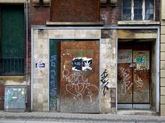 salvation (steve marland) Tags: door doors doorway sheffield architecture grafitti poster tiles window urbandecay uk england brick abandoned closed tornposter