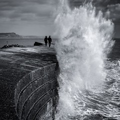 Cobb Couple (Chris Jones www.chrisjonesphotographer.uk) Tags: ocean photographer jones chris uk england west south curve wall sea seascape people couple two gareth wave stormy storm dorset regis lyme cobb