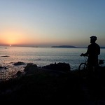 """Sunset at O Pindo on Cote de Morte, Spain. (""""Coast of Death"""" because of all the bike tires killed, like mine) ...actually, ships 🚢). With @617rozzie, thinking 🤔 thumbnail"""
