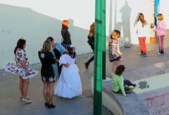 Skirt Issues - Cadiz, Spain (TravelsWithDan) Tags: firstcommunion whitedress windonskirt people outdoors city urban beach longlight candid streetphotography cadiz spain canong16 children