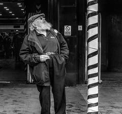 Trickier than a chimney (Marion McM) Tags: man beard hat pole stripes santa santaclaus fatherchristmas christmas candid streetphotography christmaseve humour canonpowershotg7xmarkii london eustonstation england uk 2018 festive