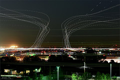 SFO's Saturday Night (milton sun) Tags: sfo longexposure dusk california sky evening nightphotography nightscene traffictrails traillights airplane aircraft house sanfranciscointernationalairport airport