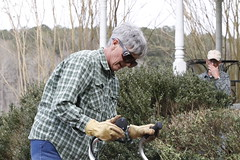 Martha Coleman works on a garden in front of her house in as Ray Coleman watches on.