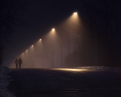 foggy night walkers (marianna armata) Tags: fog night winter couple walking perspective street urban lights mariannaarmata