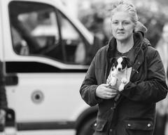 Puppy lover (Frank Fullard) Tags: frankfullard fullard candid street portrait puppy dog lover monochrome black white blanc noir ballinasloe horse fair galway irish ireland face kind blonde