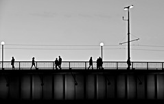 in the middle of the bridge (christikren) Tags: austria bridge blackwhite christikren candid human lines linz light noiretblanc panasonic photography people street silhouette sw sky travel tourist urban lamps laterns