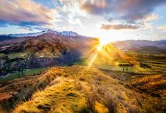 Crossing the Range (Trey Ratcliff) Tags: newzealand queenstown stuckincustoms stuckincustomscom treyratcliff crown range mountains landscape sunset hill valley sun clouds snow aurorahdr hdr hdrtutorial hdrphotography hdrphoto