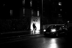 Crossing (pascalcolin1) Tags: paris13 femme woman nuit night lumière light voiture car croisement crossing phares flagship pluie rain reflets reflection photoderue streetview urbanarte noiretblanc blackandwhite photopascalcolin 50mm canon50mm canon